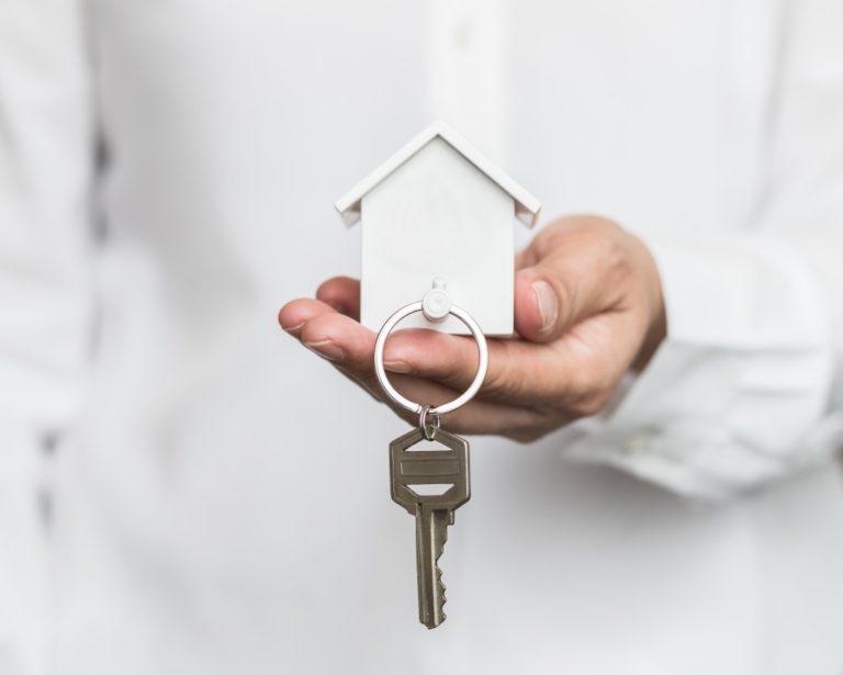 holding keys to house