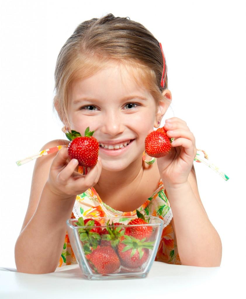 kid holding strawberry